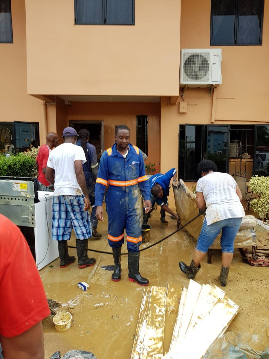 Flashback: TSTT staff assisting with clean up efforts after the major flooding in October.