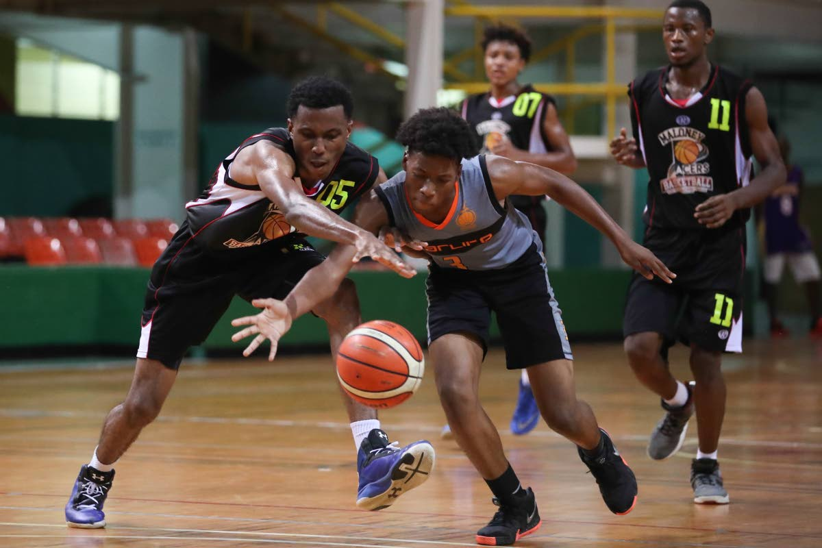 Pacers' Shakiel Isertrand (#5) and SOS's Nickolai Mills )#3) go head-to-head for a lose ball, during the 2nd game of the Finals of the U-19 Barry Stewart Basketball League between Maloney Pacers and SOS Academy at the Jean Pierre Complex, Mucurapo,on Saturday.