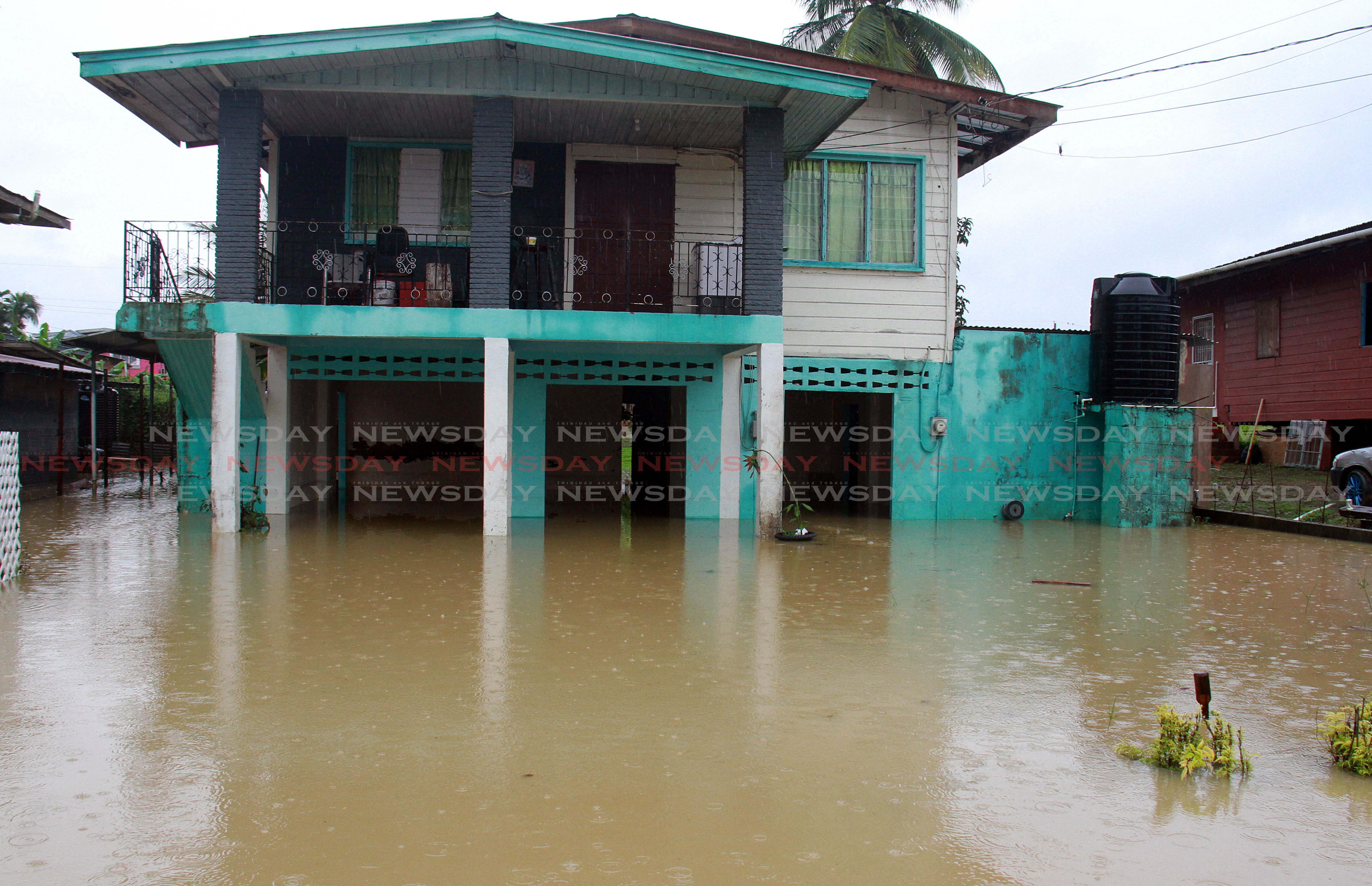 Flood waters at Debe Trace, Debe.  PHOTO BY ANIL RAMPERSAD.