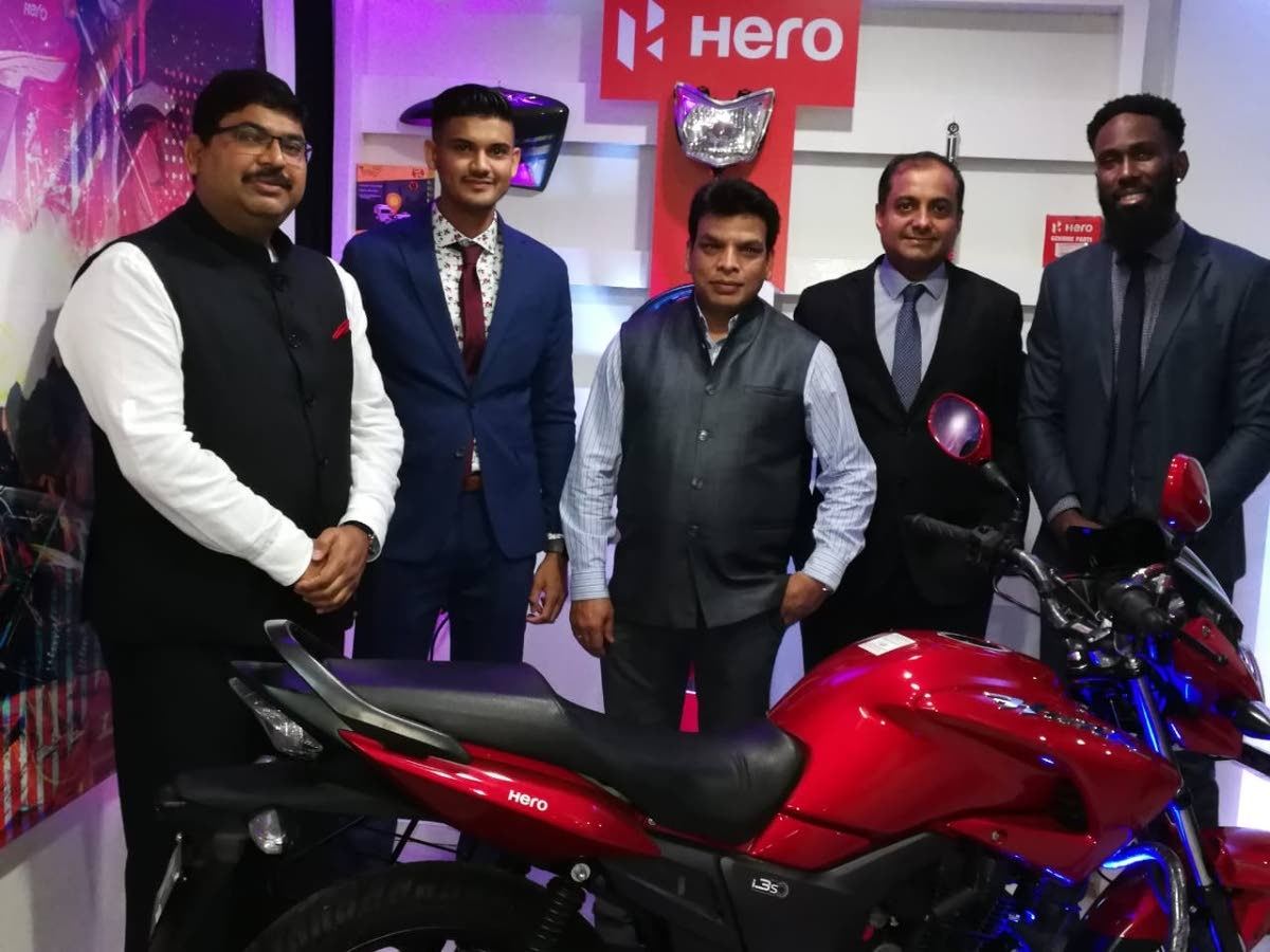 Indian High Commissioner Bishwadip Dey; Joshua Ramdehol, general manager, Hero Caribbean; Dr Deepak Pandey and Aniruddha Das, both second secretary at the Indian High Commission; and Damion Richards, Hero country manager at the official launch of Hero Motocorp operations in TT.