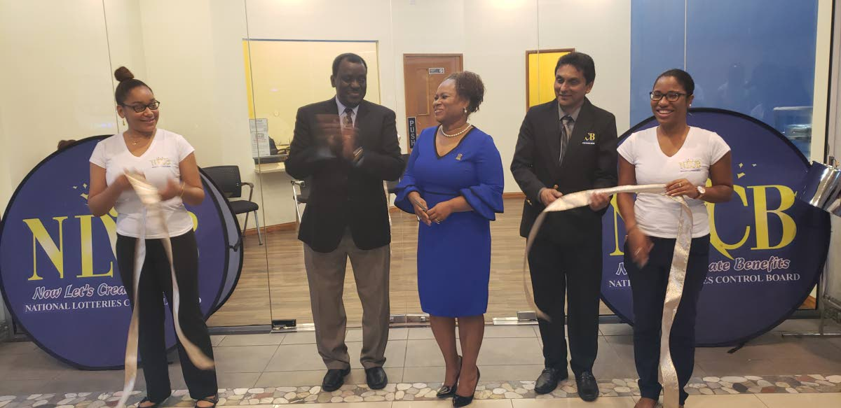 National Lotteries Control Board Directors Selby Browne, second from left, and Michael Jogee, along with Presiding Officer of the Tobago House of Assembly legislature, cut the ribbon to open NLCB's first flagship story in Trinidad and Tobago at the Gulf City mall in Lowlands last Thursday.