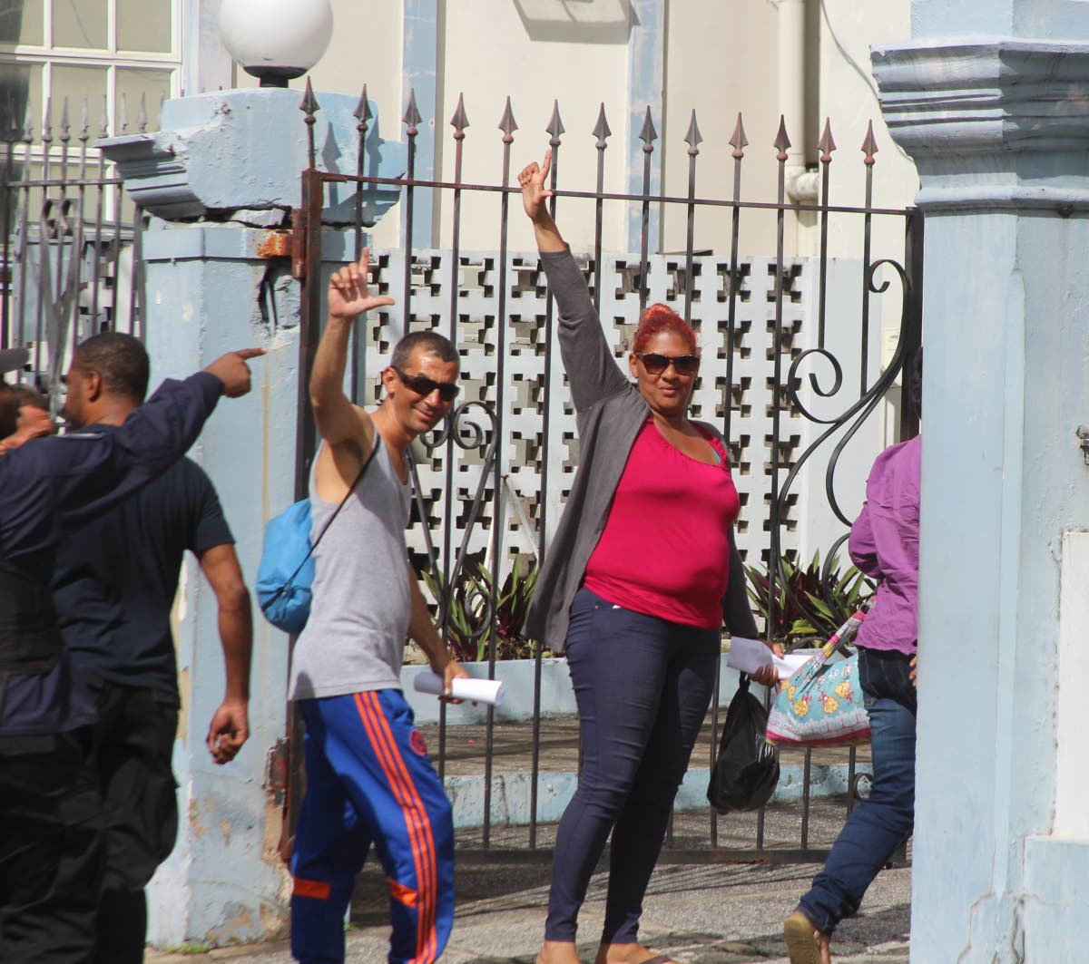 File photo: Cuban asylum seekers who were arrested outside the United Nations office at Chancery Lane, Port of Spain wave as they arrived at the Port of Spain Magistrates Court last Friday.