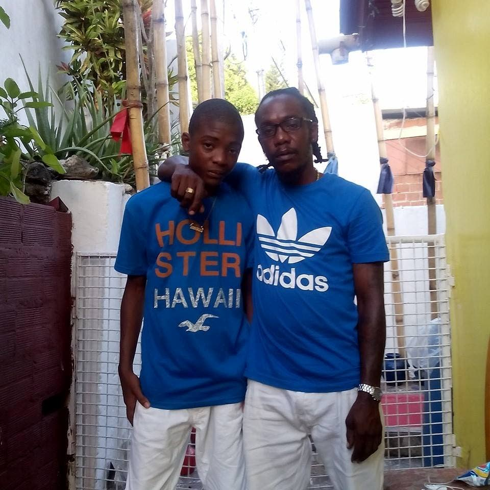 Dwane Thomas, right, with one of his sons, Jabari. Dwane rescued a woman and her baby from a fire in San Juan yesterday.