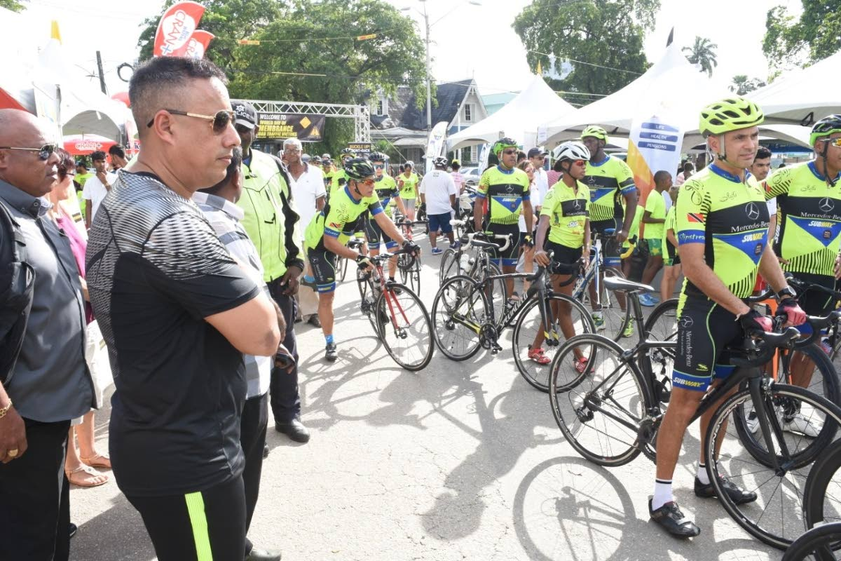 Commissioner of Police Gary Griffith (second from left) looks at a group of cyclists during the World Day of Rememberance for World Traffic Victims held Saturday at the Queen's Park Savannah.