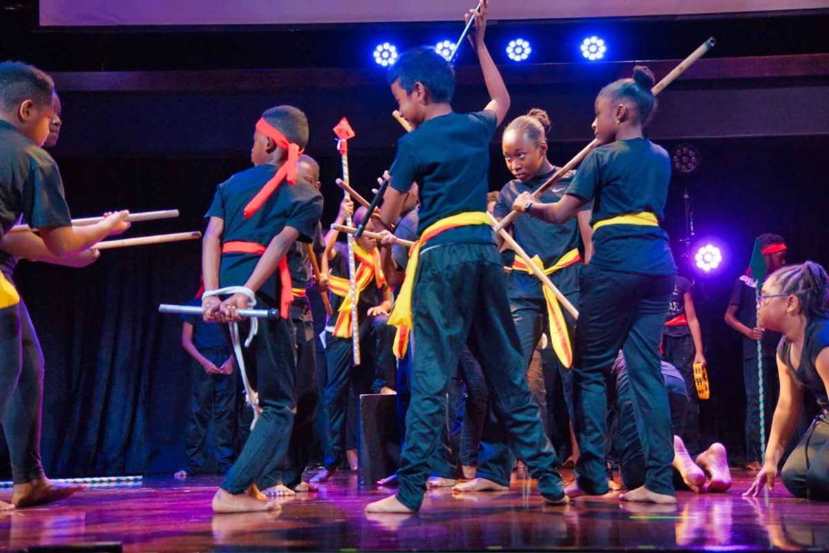 Students of Trinity Junior School perform their dramatic adaptation of the story of Hyarima's Last Feast at the Central Bank  Auditorium, Port of Spain.