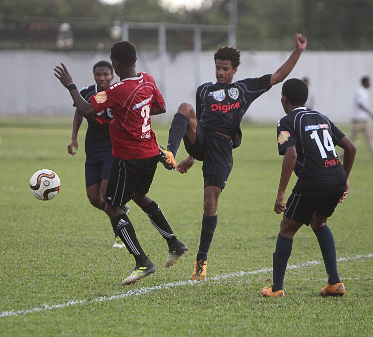 A QRC player tries to win the ball with a high challenge against St Anthony's College in a North Zone Intercol semi-final yesterday at Fatima Grounds, Mucurapo.