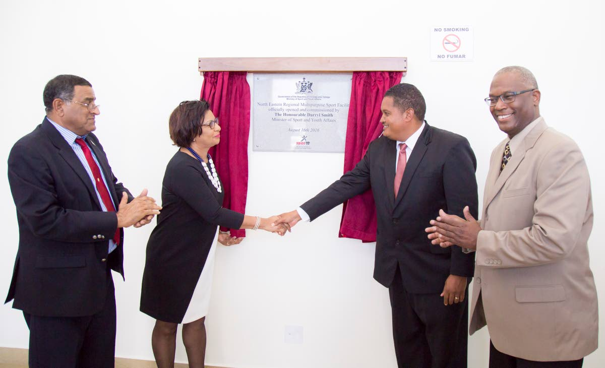 GRAND OPENING: Former Sports Minister Darryl Smith, second from right, shakes the hand of Toco/Sangre Grande MP Glenda Jennings-Smith, as Councillor Terry Rondon, left, and former Toco/Sangre Grande MP and Sport Minister Roger Boynes look on at the opening of the North Eastern Regional Multi-purpose Sport Facility in 2016.