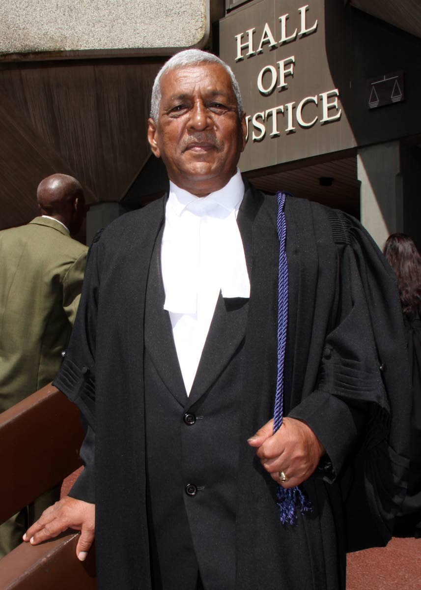 READY TO SERVE: Retired Permanent Secretary of the Public Utilities Ministry Chrisendath Mahabir, who along with 64 others, took the oath as new lawyers yesterday at the Hall of Justice in Port of Spain. PHOTO BY ROGER JACOB