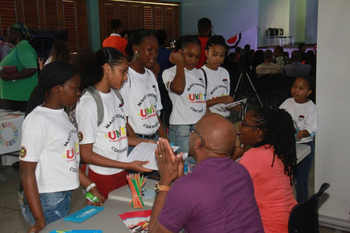 KNOWLEDGE: These young people were quite eager to get information about seeking out and being positive role models at a symposium held on Saturday at the Enterprise Government Primary School.