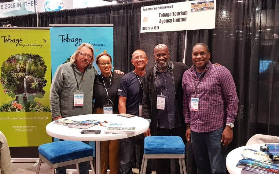 From left, Sean Robinson, President of Association of Tobago Dive Operators; Sheena Des Vignes, TTAL Marketing Coordinator; Derek Chung, Owner of Undersea Tobago; Fabian Vincent, visitor, and Louis Lewis, Chief Executive Officer of the Tobago Tourism Agency (TTAL) pose for a photo at the USA Diving Equipment and Marketing Association (DEMA) show in Las Vegas, USA.     TTAL targets USA Divers at DEMA Show The Tobago Tourism Agency Ltd (TTAL) led a delegation from Tobago to the USA Diving Equipment and Marketing Association (DEMA) show in Las Vegas from November 14-17. This trip follows one to the Birmingham Dive Show in the UK last month.  A statement from TTAL said the November 14-17 mission was part of its strategy to increase visitor arrivals to Tobago, focusing on the dive niche. It said the DEMA show was an exclusive trade partner event that brings together key members of the international dive industry, including retailers, tour operators and destination promoters and that attendees are exposed to