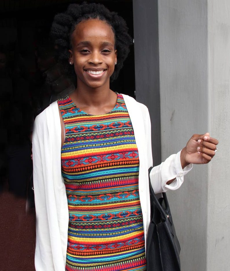 File photo: Gymnast Thema Williams smiles after winning her case against the TT Gymnastics Federation.