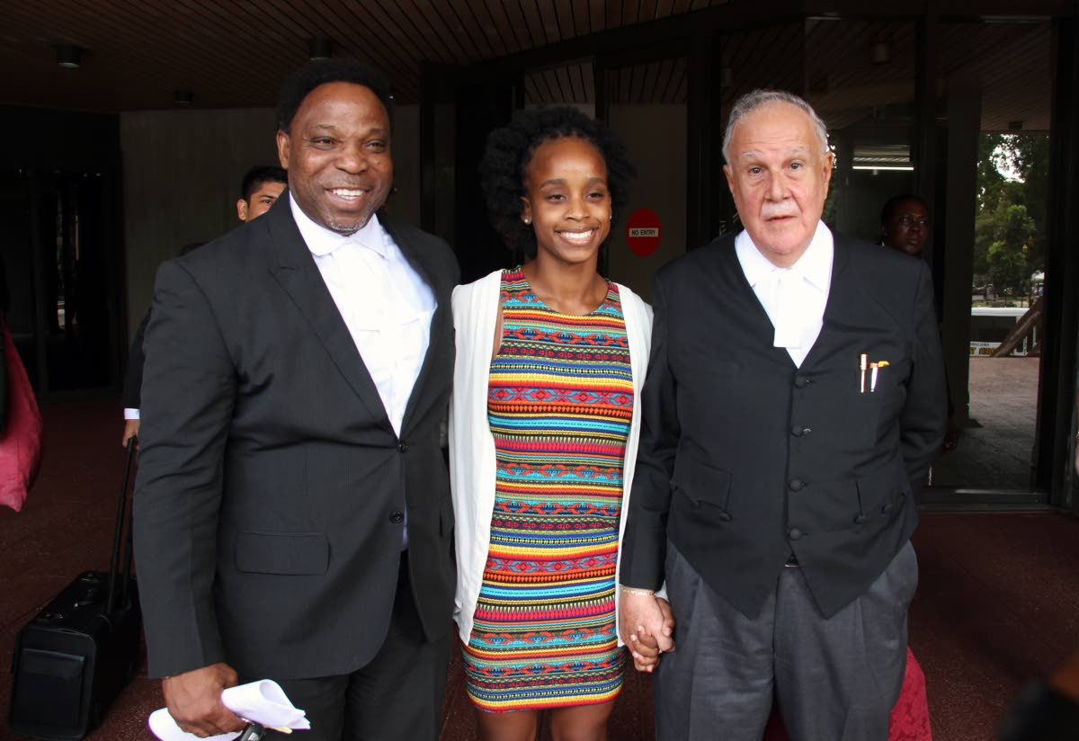 COURT WIN: Gymnast Thema Williams with her attorneys Martin Daly, SC, and Keith Scotland, left, at the Hall of Justice in Port of Spain yesterday. PHOTO BY SUREASH CHOLAI