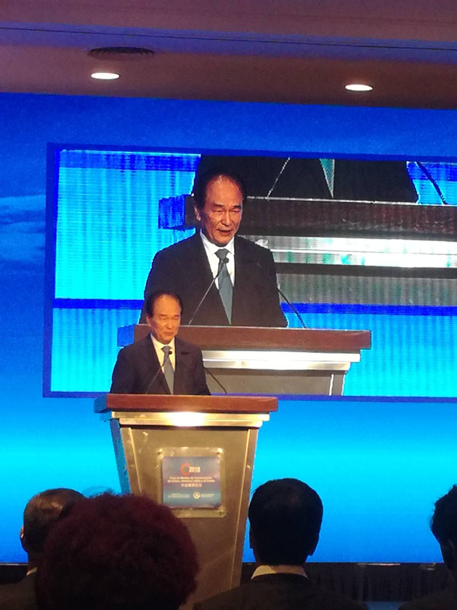 President of Xinhua News agency Cai Mingzhao speaks at the China Caribbean and Latin America media forum last week in Buenos Aires, Argentina.  Photo by Ken Chee Hing