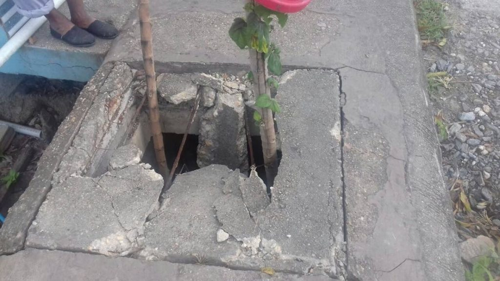 The broken manhole cover in which Shenate Kim Lee fell and sustained injuries
