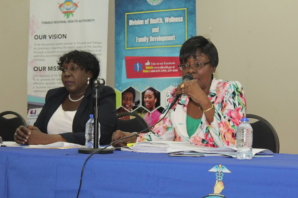Health Secretary Agatha Carrington, right, responds to concerns from villagers at a community meeting at the Betsy's Hope/Louis D'or Multipurpose facility hosted by the Division of Health and the Tobago Regional Health Authority (TRHA) last Wednesday. At left is Ingrid Melville, Chairman, TRHA.