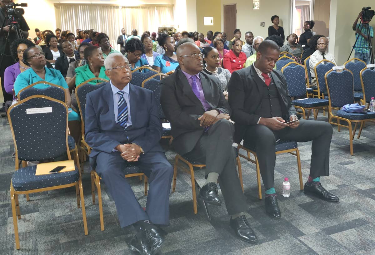 """From left, front row, Education Minister Anthony Garcia sets with Chief Secretary Kevin Charles and Minister of State in the Ministry of Education Dr Lovell Francis at Tuesday'snational consultation on the Draft Education Policy Paper titled, """"A Look into the Future,"""" at the Victor E Bruce Financial Complex in Scarborough."""