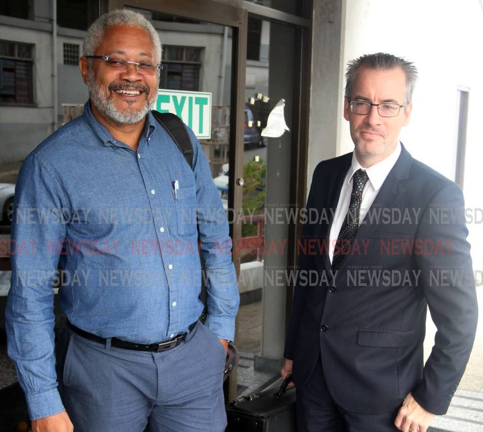 Afra Raymond (left) with his attorney Kingsley Walesby outside the San Fernando High Court yesterday PHOTO BY: ANSEL JEBODH
