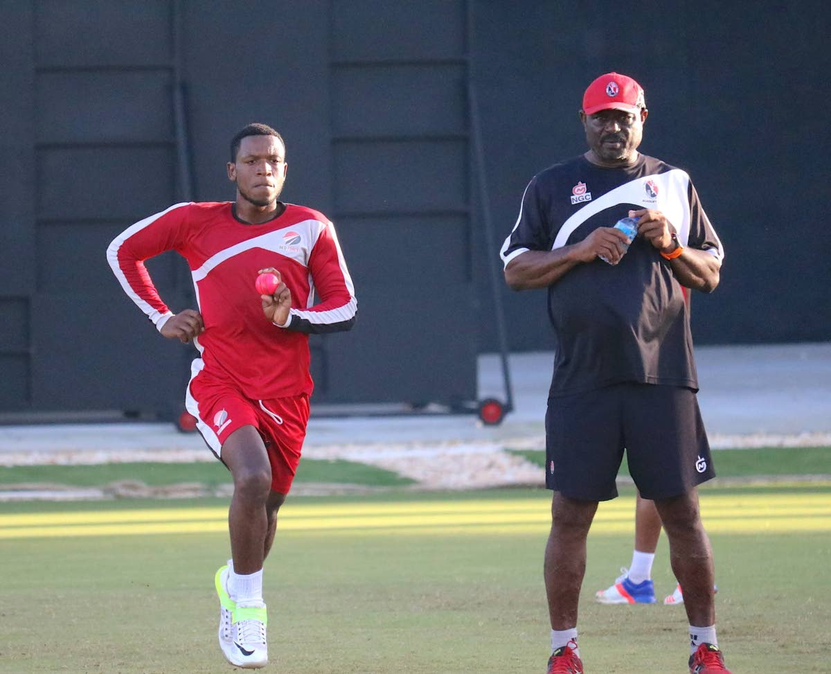 FLASHBACK: National coach Kelvin Williams, right, looks on as pacer Daniel St Clair, left, bowls during a training session.