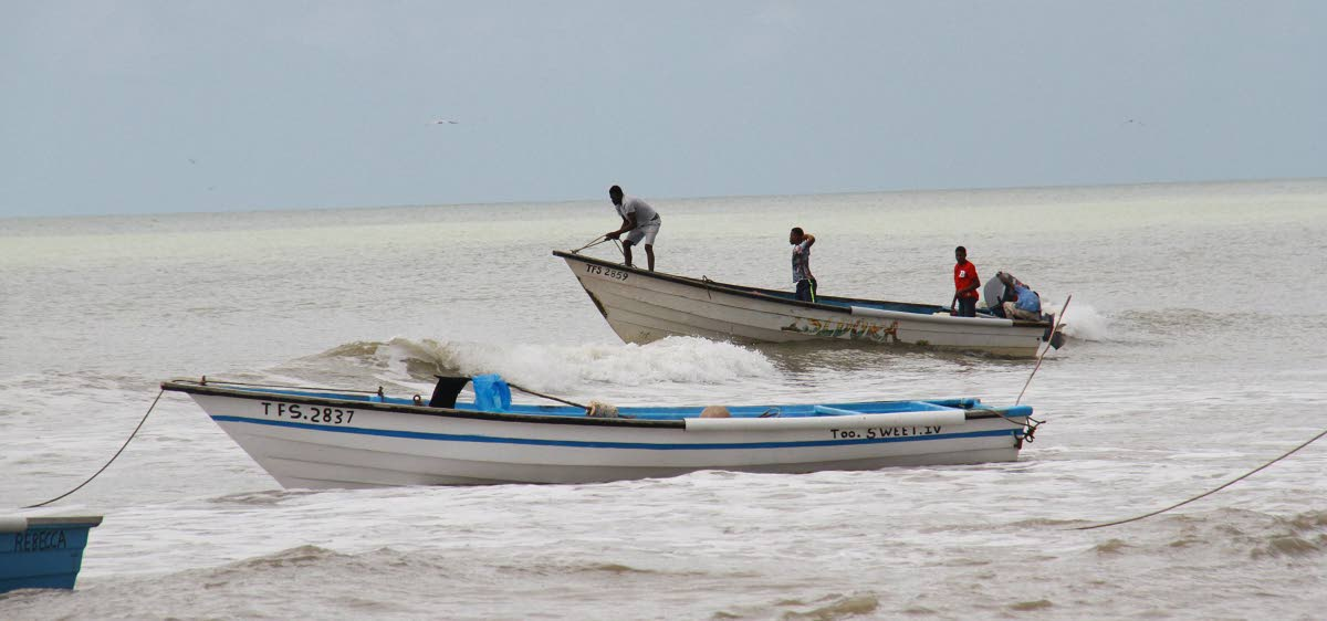 In this February 2018 file photo, fishermen head out to sea off the coast of Erin.