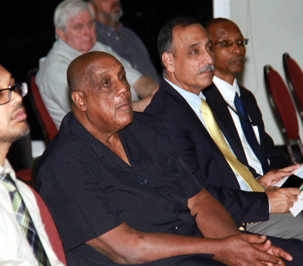 In this July 27 file photo, chairman of the UTT Board of Governors,  Professor Kenneth Julien, left, listens alongside UTT president Professor Sarim Al-Zubaidy to presentations at a seminar–The Transition to Utility Scale Renewable Energy Generation–at UTT's Point Lisas campus. PHOTO BY ANIL RAMPERSAD.