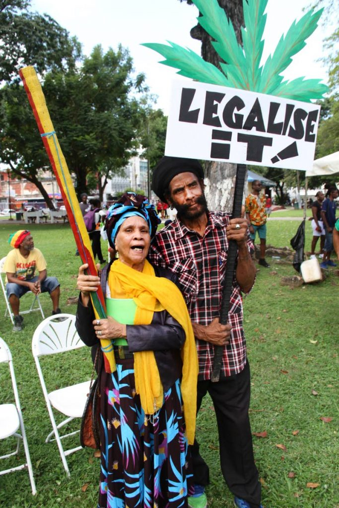 In this October 14 file photo, Theodora Uleria (Auntie Tia) and Claude Jeffers join the call to legalise the use of marijuana during the All Mansions of Rastafari's Cannabis Rally at Woodford Square in Port of Sapin.