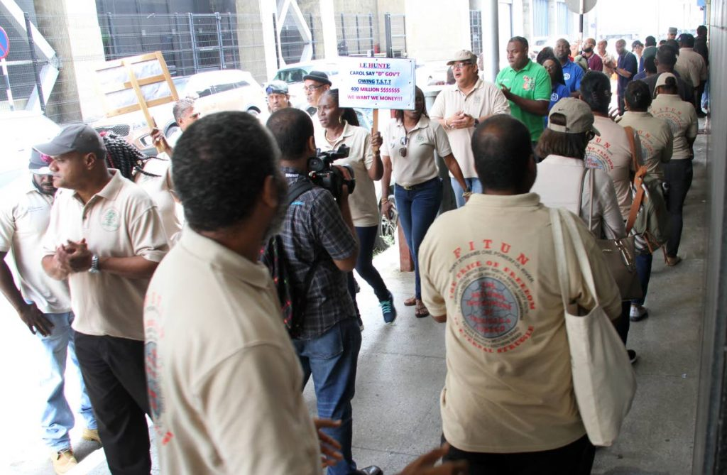 In this November 16 file photo, members of the Communication Workers Union protest outside TSTT's head office on Edward Street in Port of Spain over the company's plans to retrench 503 workers. The retrenchment went ahead and the company also sent home 51 non-union staff, including senior managers earlier this month. Photo by Sureash Cholai