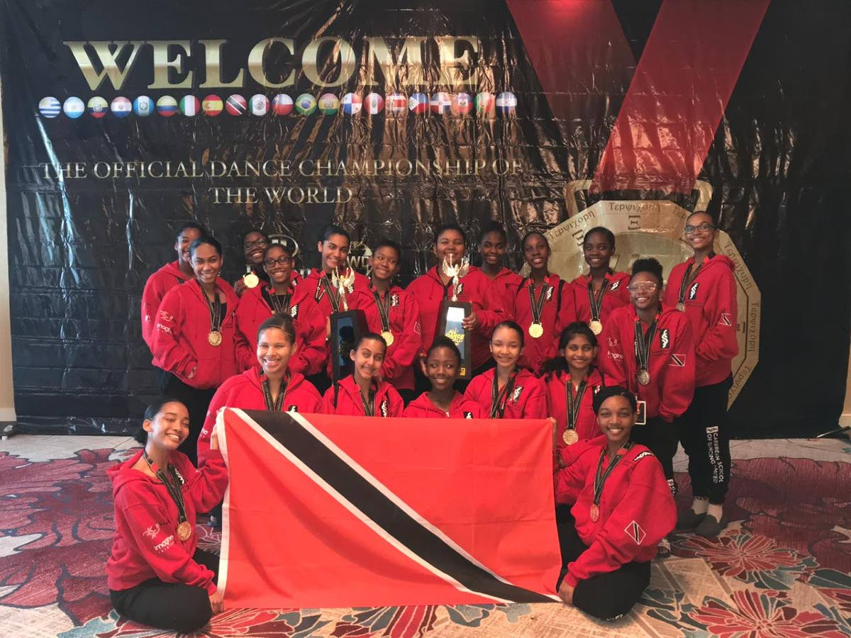 The group of 18 in the  12-17-year-old category with two of the three trophies won by the the Caribbean School of Dancing.