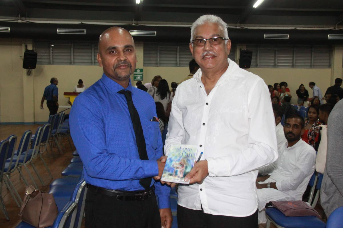 Dr Prithiviraj Bahadursingh, author of For The Love of Pan, and Minister of Health Terrence Deyalsingh at the November 25 book launch at the Naparima Girls' High School.