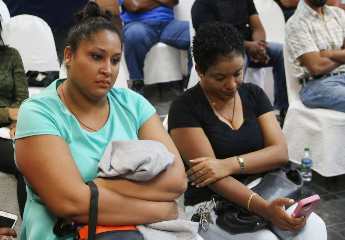 NOTHING: Tears stream down the faces of Raisa Greenbank (left) and Gabriella Martin yesterday as Petrotin refinery offically closed sending them home as tempoary workers with nothing.