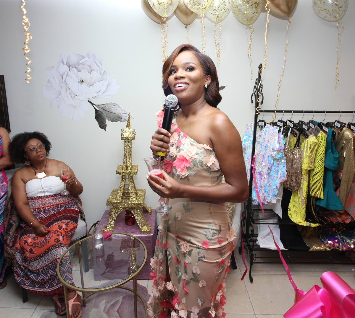 Former Ms TT Universe Yvonne Clarke addresses guests at the launch of her first boutique.