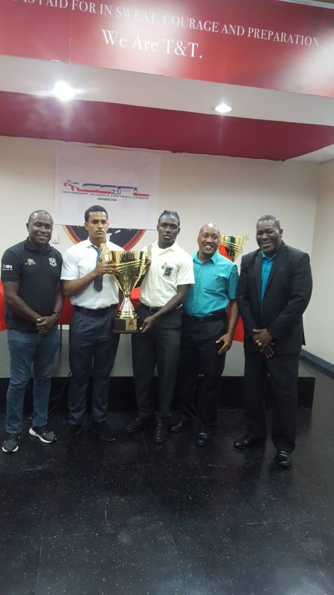 READY TO RUMBLE: (From left) Naparima coach Angus Eve, Naps captain Levi Fernandez, San Juan North skipper Ronaldo Boyce, San Juan coach Steven Clarke, and SSFL boss William Wallace at yesterday's pre-match press conference.