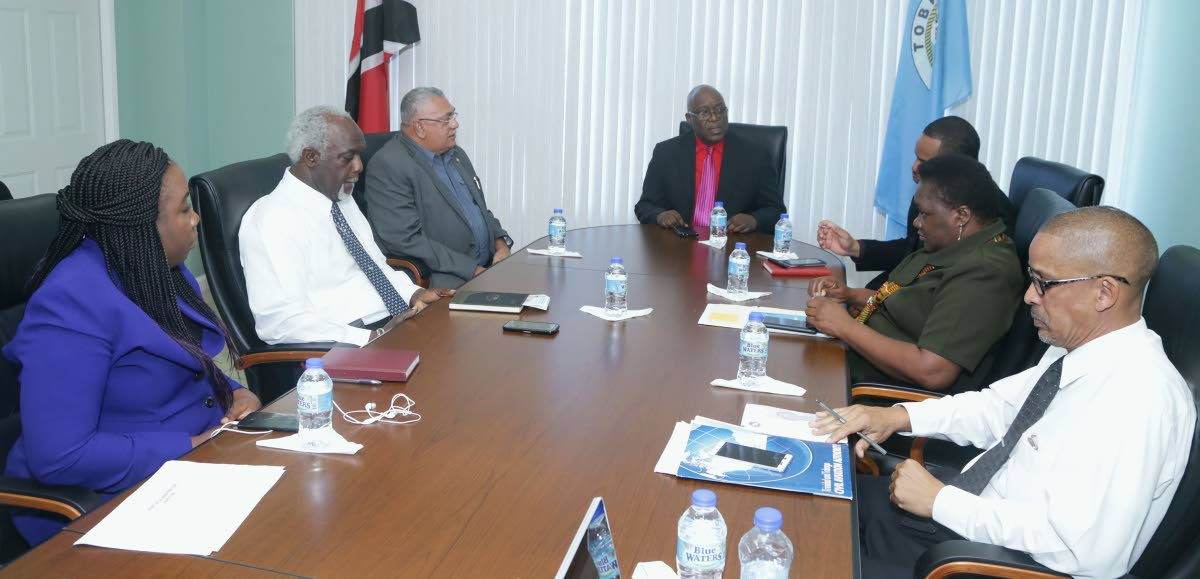 Ferry talks: Chief Secretary Kelvin Charles, centre, talks with representatives of the Port Authority of Trinidad and Tobago (PATT) at the Division of Education on Monday. From left are PATT's acting Finance Manager, Nadine McKenzie, Terminal Manager Godfrey Redman, Board Commissioner Tommy Elias, Secretary of the Division of Infrastructure Kwesi Des Vignes, acting Administrator at the Division of Tourism Hazel Peterkin, and the Division's Marketing Officer, Nigel Wilson.