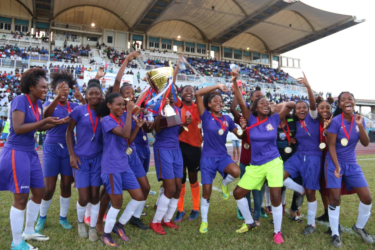 Pleasantville Secondary players celebrate their 3-0 win against Signal Hill Secondary, at the National Intercol final yesterday, as they took home the SSFL title, at Ato Boldon Stadium
