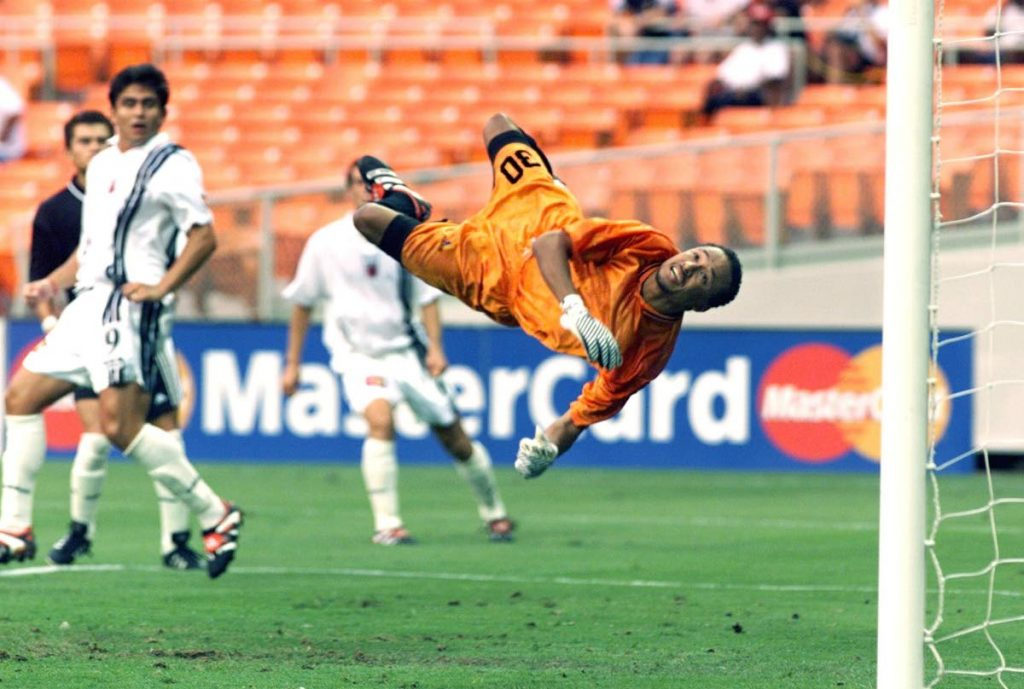 Then Joe Public FC goalie Michael McComie (right) dives to stop a shot while DC United forward Jamie Moreno (left) looks on during the first half of the 1999 CONCACAF Club Championship quarter-final match at the RFK Stadium in Washington, DC, US.