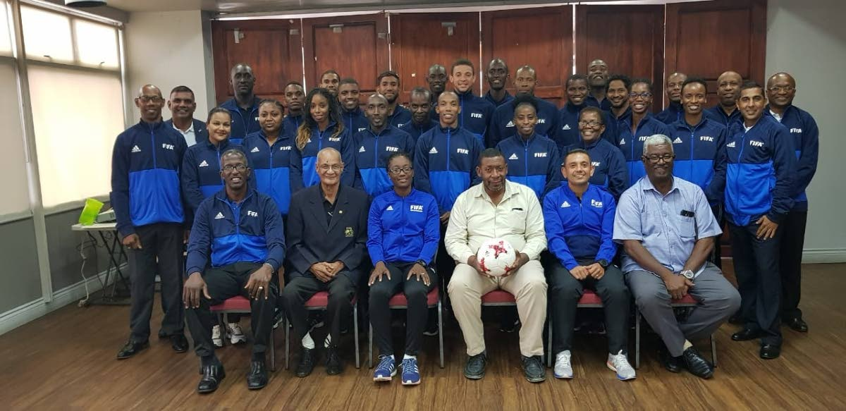 TTFA president David John-Williams, seated centre, with FIFA and local course administrators as well as participants of last week's FIFA Referee Assistance Programme, VIP Lounge, Hasely Crawford Stadium, Mucurapo.