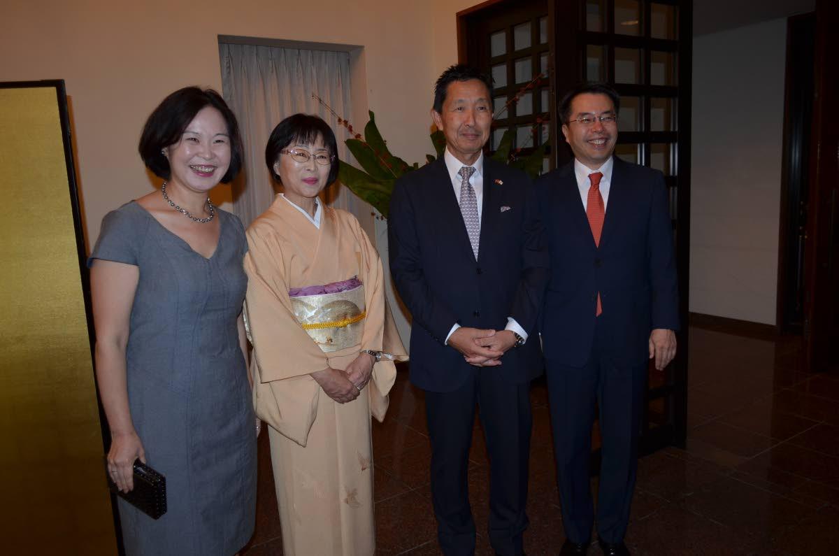Japanese Ambassador Mitsuhiko Okada and his wife Mari centre, welcome Korean Ambassador Sung Moon-up and his wife Cho Woohyun to the celebration