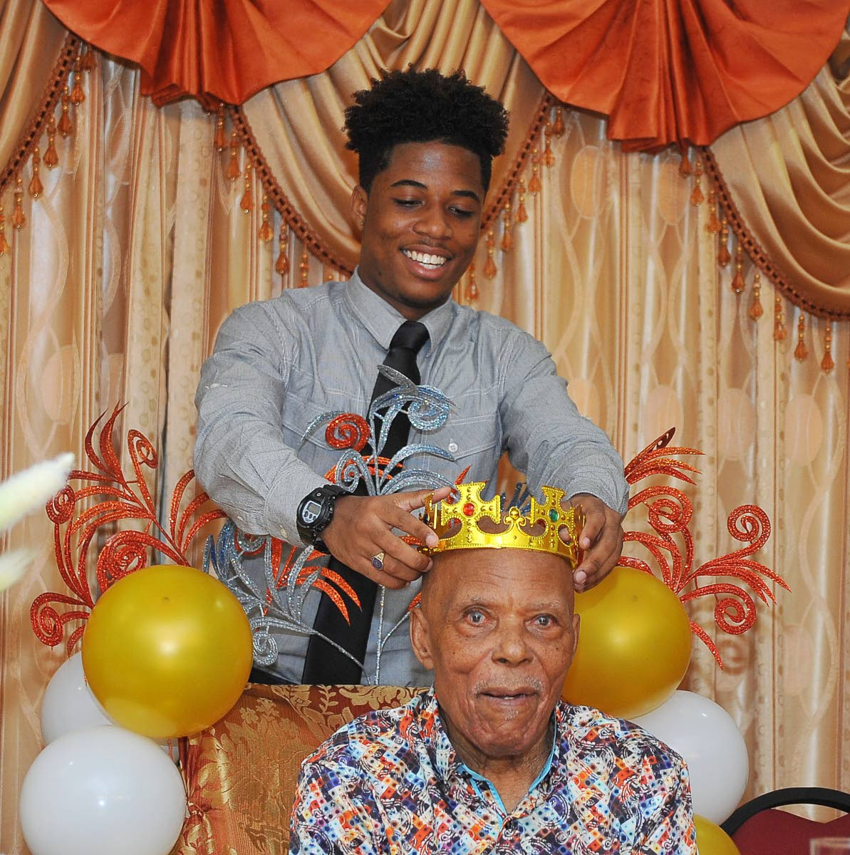 Justin McLeod places a crown on his grandfather Stephenson Callender.