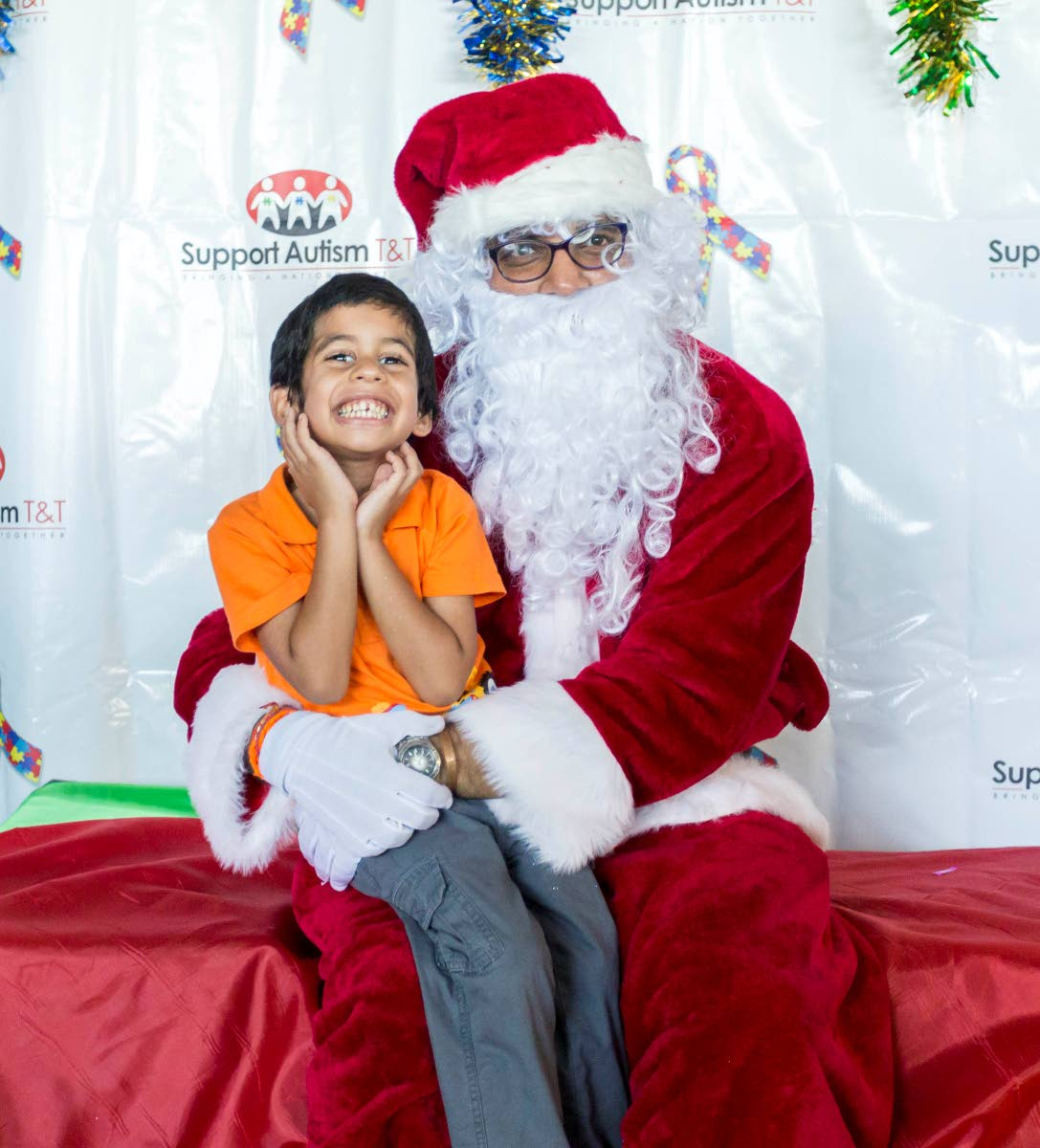 So excited to be with Santa at Support Autism T&T's Christmas party.