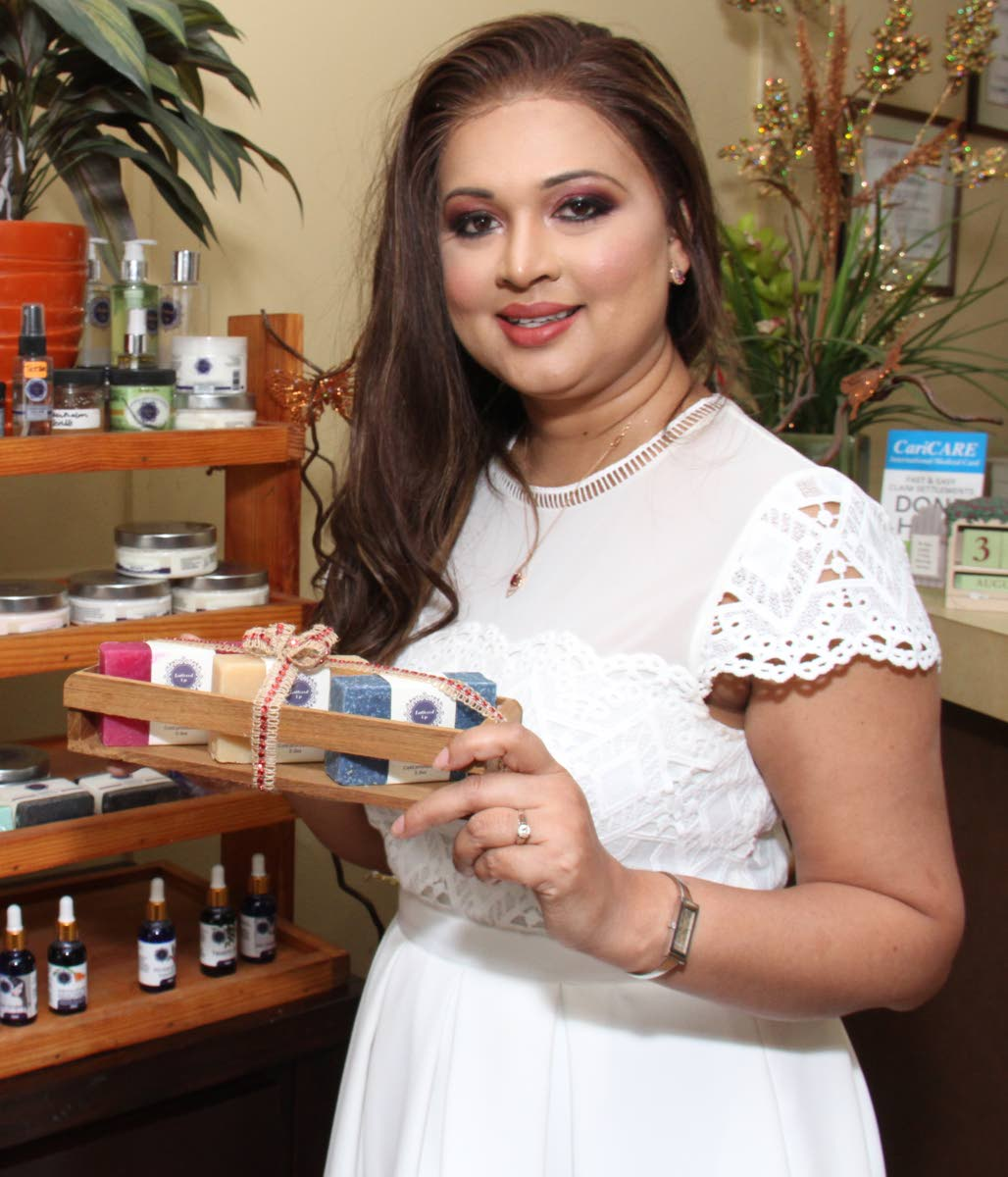 Dental surgeon Dr Caroline Singh and a range of her Buttered Up products. PHOTOS BY ROGER JACOB