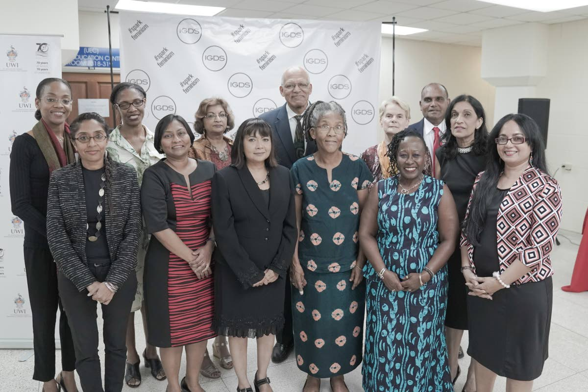 Some of the 77 exceptional female UWI graduates honoured at last Thursday's opening of the UWI 70th anniversary exhibition 70+ Outstanding UWI Women, with UWI faculty and staff,  at the Alma Jordan Library, St Augustine.  Back row from left,  animal surgeon Dr Ayanna Carla Phillips; forensic linguist Dr Sandra Evans; feminist filmmaker Prof Patricia Mohammed; Pro Vice-Chancellor for Graduate Studies and Research Prof Stephan Gift; social historian Prof Bridget Brereton; Alma Jordan Librarian Frank Soodeen; and applied science and technology specialist Prof Neela Badrie. Front row: IGDS St Augustine Head Dr Gabrielle Hosein; left, vulcanologist Dr Eroucilla Joseph; economics and crime scholar Dr Sandra Sookram; writer Dr Merle Hodge; project head Prof Opal Palmer Adisa; and astronomer Dr Shirin Haque.