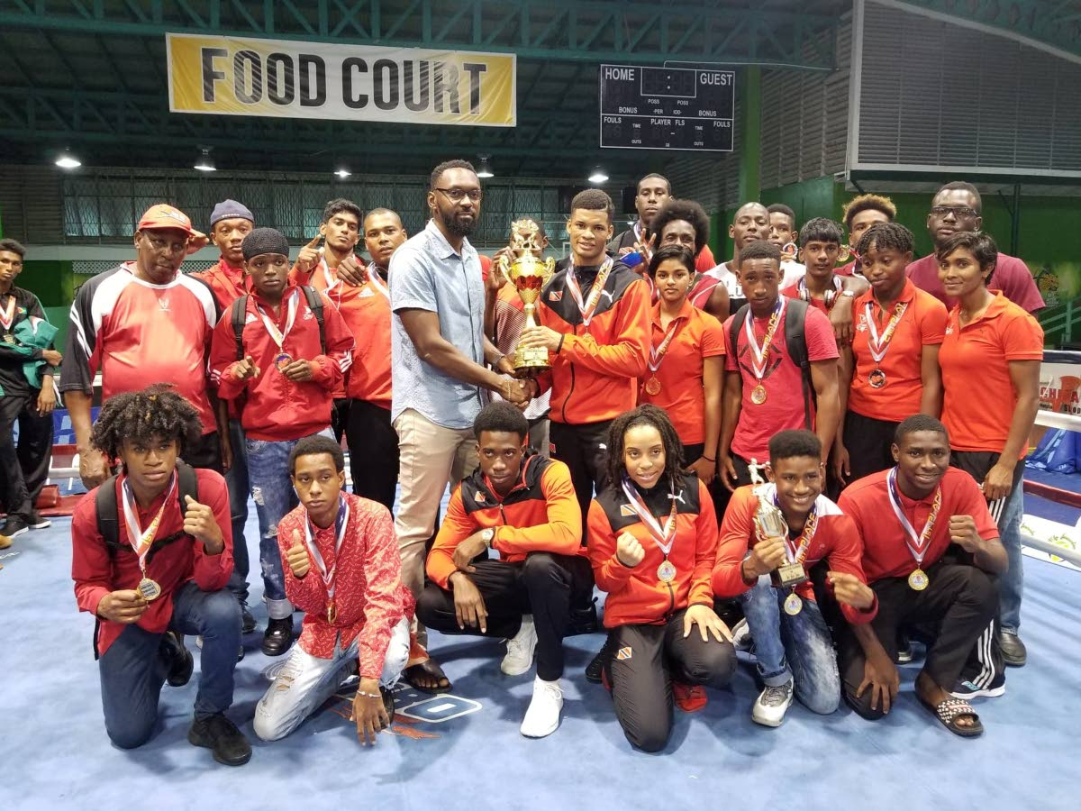 BIG HAUL: TT boxers with their trophy and medals in Guyana after winning 18 medals at the 2018 Caribbean Championships.
