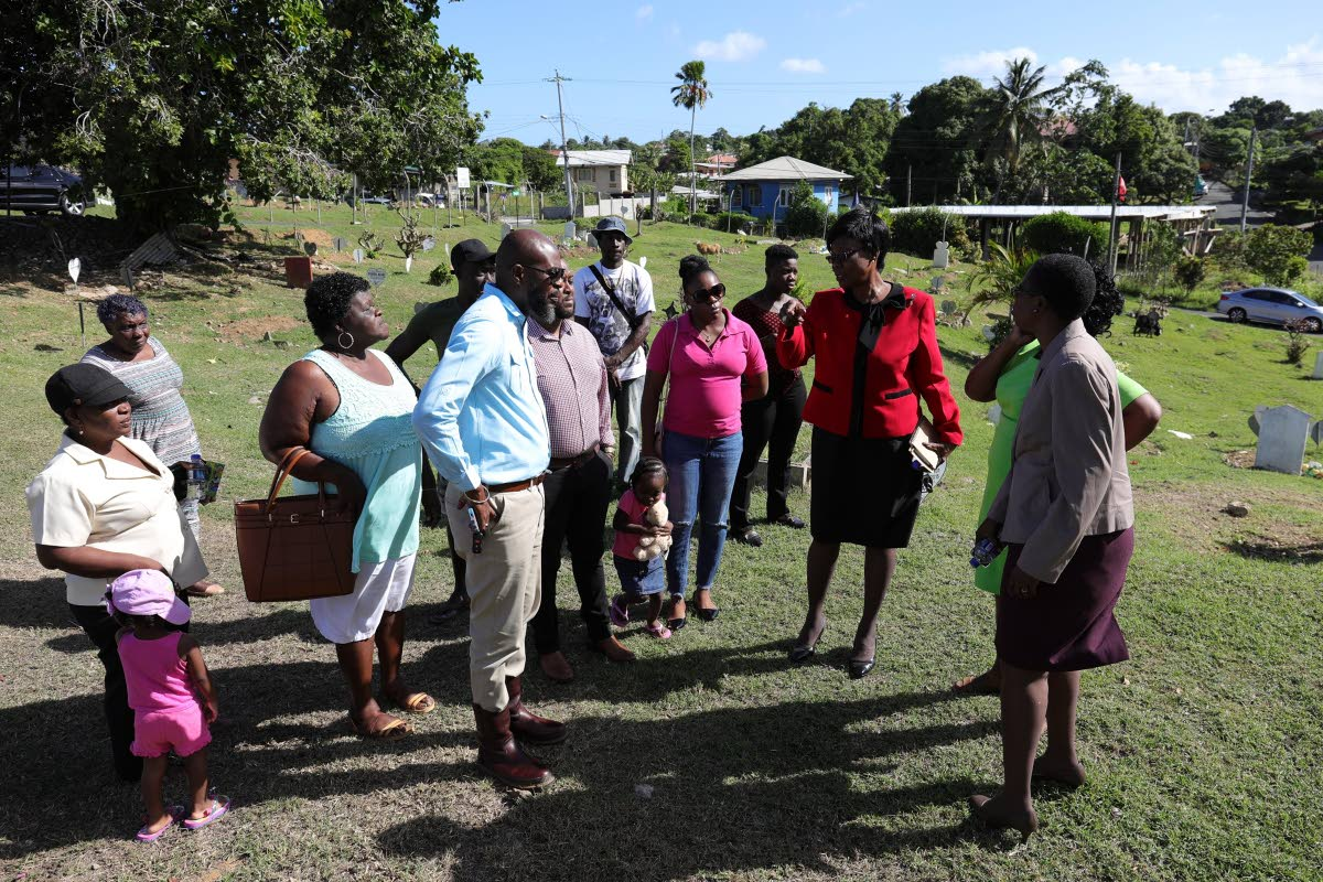 Health Secretary Dr Agatha Carrington, third from right, holds discussions on upgrade works at the Plymouth public cemetery at the construction site on Monday. THA Photo