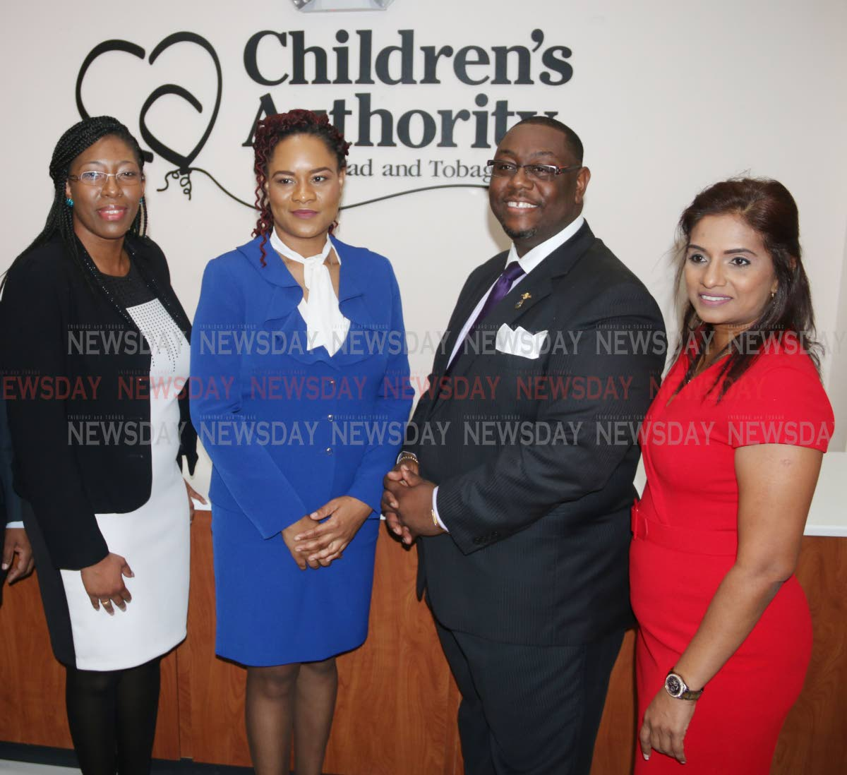 Safiya Noel Director of the Children's Authority (left) is seen standing along with Minister of State. Ofiicer of the Prime Minister Ayanna Webster-Roy (second from left), Hanif Benjamin Chairman of the Children's Authority, and Gail Sooknarine Deputy Director at the offical openning of the Children's Authority South Regional Office in Ste Madeleine PHOTO BY: ANSEL JEBODH