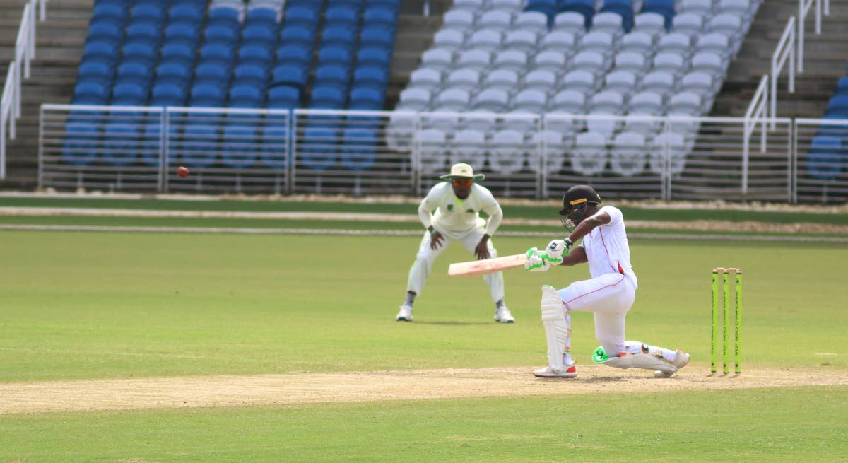 TT Red Force batsman Jason Mohammed plays a shot yesterday against the Windward Island Volcanoes, as play resumed on Day 2 of the Regional Four-Day clash at the Brian Lara Cricket Academy, Tarouba.