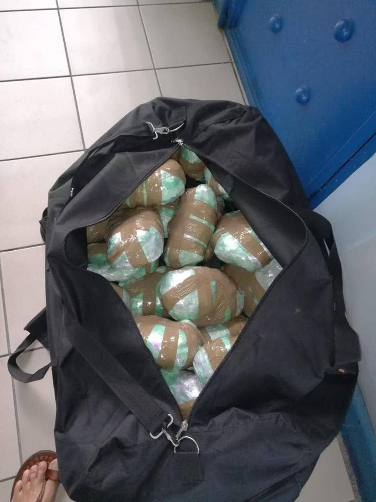 A bag containing a quantity of compressed marijuana found in a shipment of beers at Caribbean Bottlers Co Ltd, Macoya, yesterday.  PHOTO COURTESY TTPS