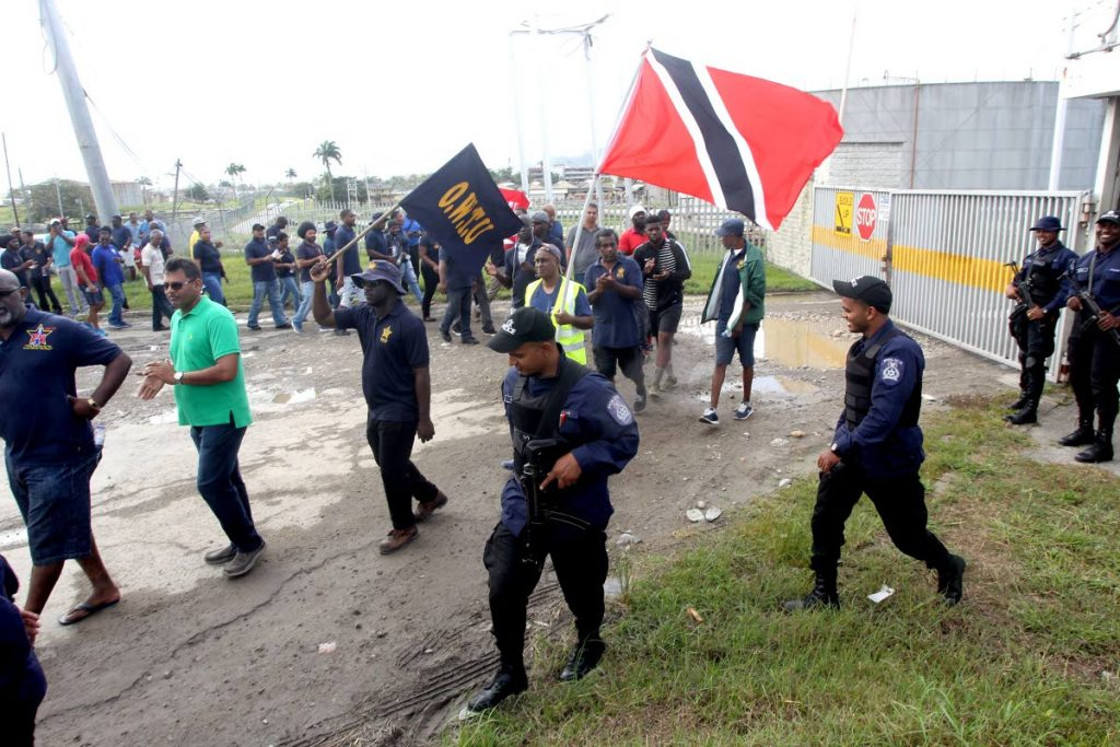 In this December 17 file photo, former Petrotrin employees protest for backpay outside the Paria fuelling trade company, Pointe-a-Pierre bond station. Photo by Lincoln Holder