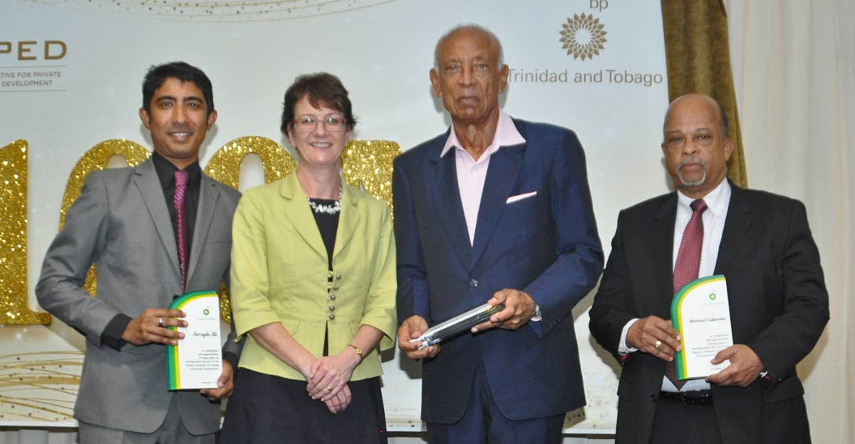 Former MIPED directors Richard Callender, right, and  Ken Gordon  with  their Awards of Recognition presented by Claire Fitzpatrick, regional president, BPTT and  Miped manager Rory Jitta.
