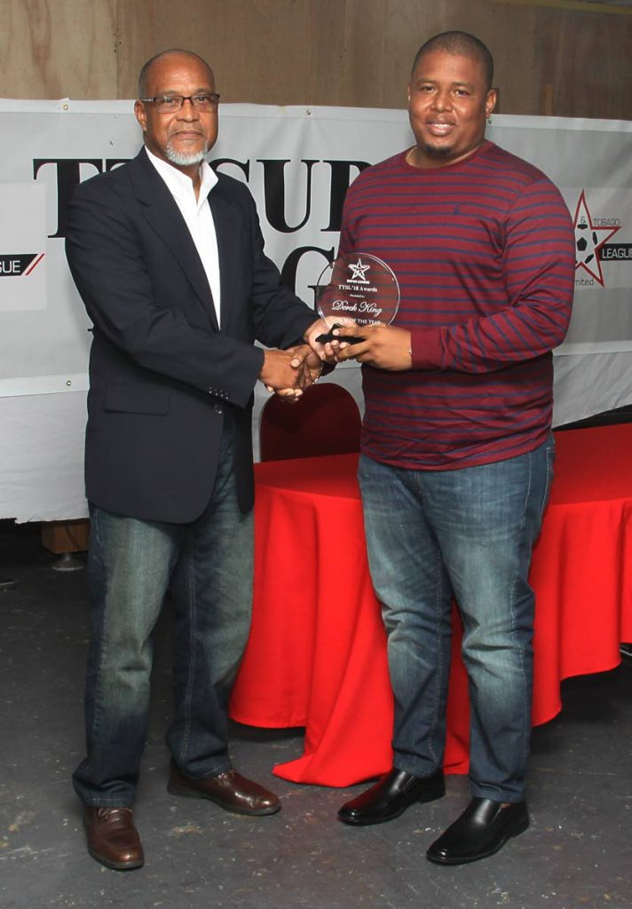 Derek King, right, collects the Coach of the Year prize from Super League president and FC Santa Rosa owner Keith Look Loy.