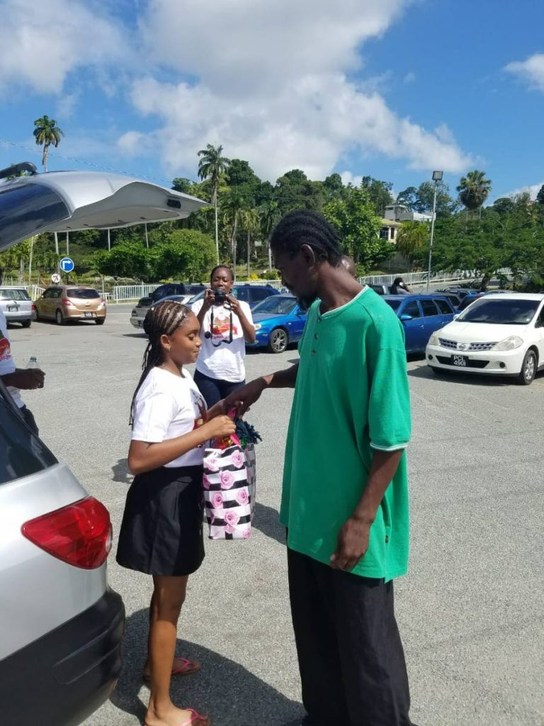 Eleven-year-old Kymora O'Shaughnessy gifts a displaced person with a hamper in Sacrborough on Monday