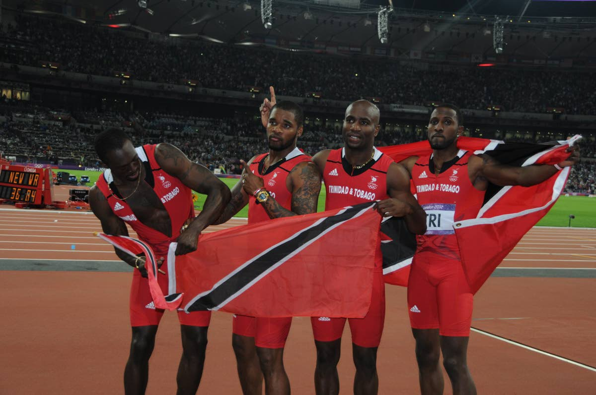 Trinidad and Tobago's olympic 2008 4x100m sprinters (from left) Marc Burns, Keston Bledman, Emmanuel Callender and Richard Thompson have been upgraded to gold by the International Olympic Committee.